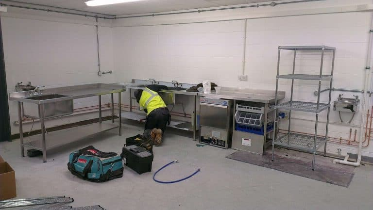 Engineer Installing commercial kitchen