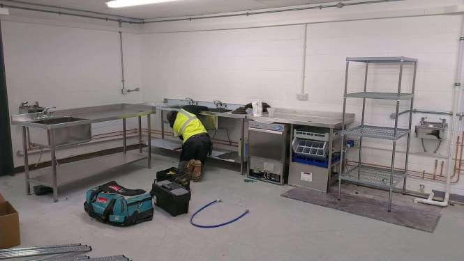 Engineer installing a commercial kitchen